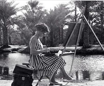Agatha Voorbrood settles herself before her easel to paint a Safwa lake Scene (Ain Daroosh), December 11, 1957.